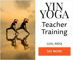 Image ad with two female yogis at beach in Goa, India for a Yin Yoga Teacher Training